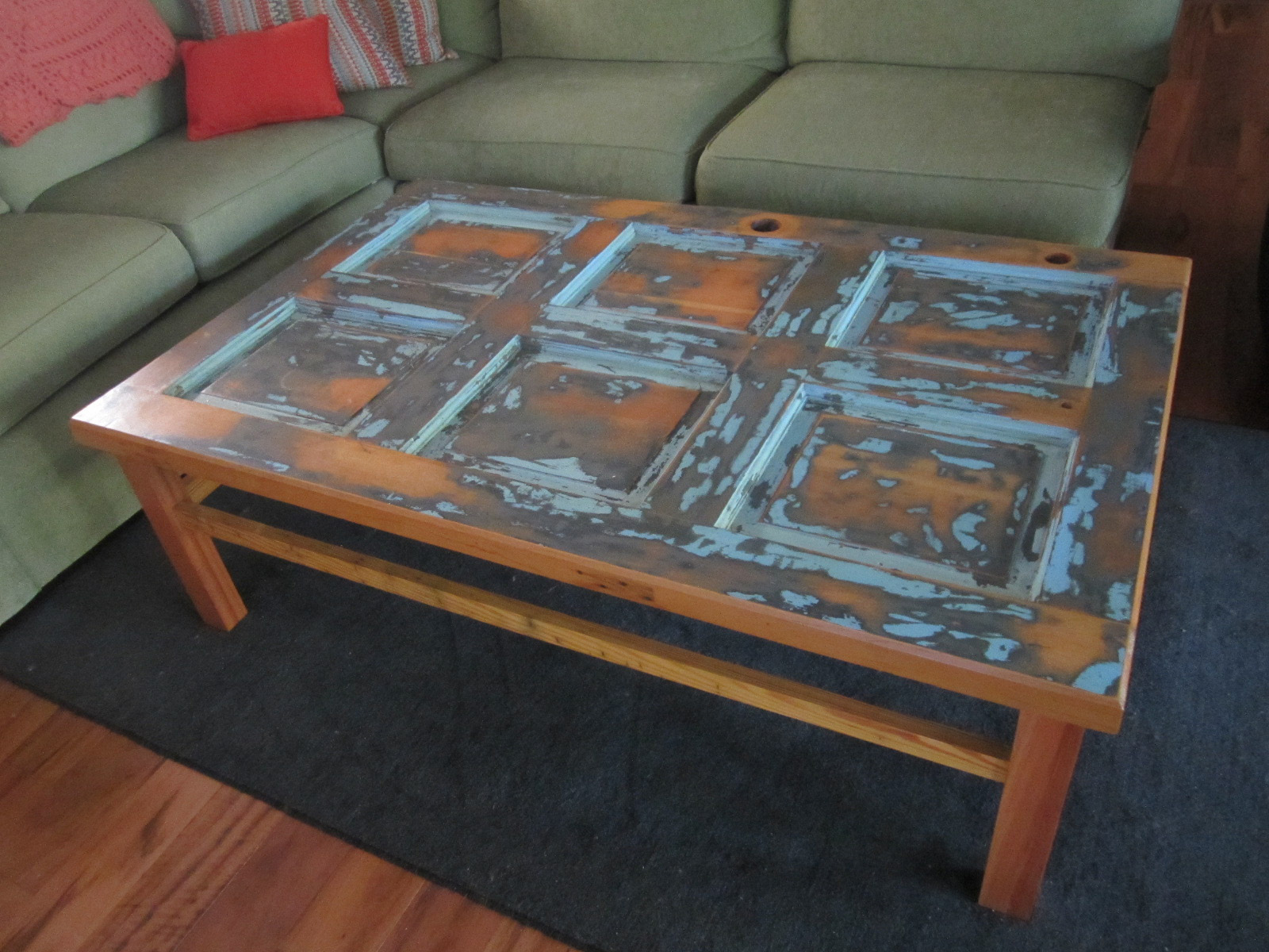 large coffee table made from 1970s solid pine door. original paint layers  revealed.