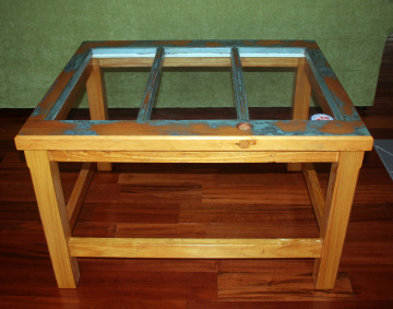 this table is made from a 1970s solid wood door taken off a house in Gainesville, Florida.